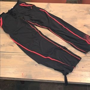 Nike dri fit pants with ties at bottom